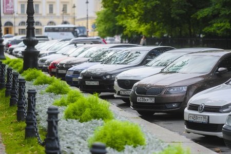 Saint-Petrsburg, Russia - August, 14, 2019: cars parking on the street in a center of Saint-Petrsburg, Russia