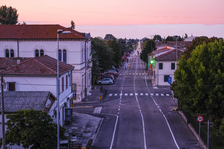 Rovigo, Italy - July, 26, 2019: landscape with the image of a road in Italy at sunset