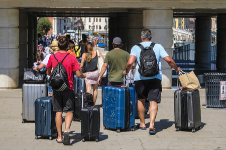 Venice, Italy - July, 11, 2019: passenges on the square of train station in Venice, Italy 報道画像