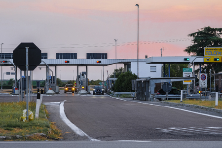 Rovigo, Italy - July, 26, 2019: highway toll station in Italy at sunset 報道画像