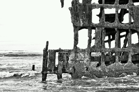 Old rusty ship on beach