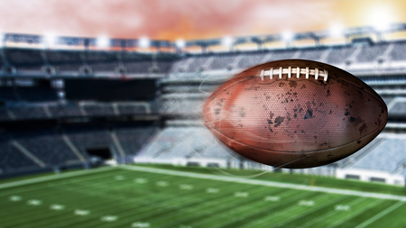 3d illustration of flying american football leaving a trail of smoke. Spinning dirty american footbal. Stock Photo
