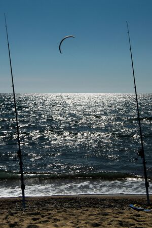 Fishing rods on the sea with kite surfing
