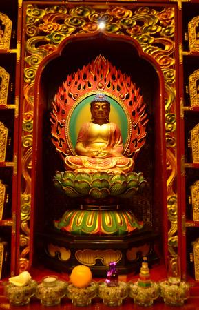 chinese buddha: Golden sitting chinese buddha image