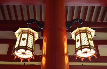 hanging lamp: Two hanging lamp at the red-brown pillar