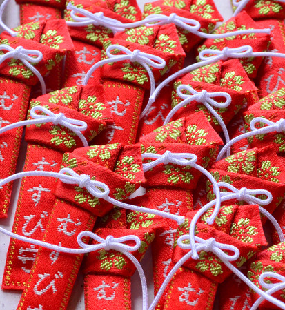 Red and white ribbon japanese amulet
