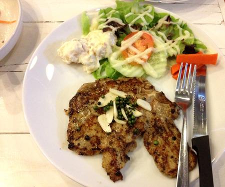pork chop: Tasty pork chop steak and salad Stock Photo