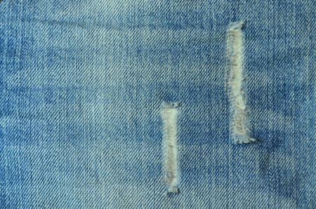 blue denim: Torn blue denim jeans