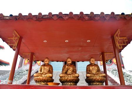 chinese buddha: Three golden seated chinese buddha image