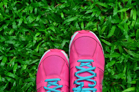 young girl feet: Pink Sport Shoe On Green Grass