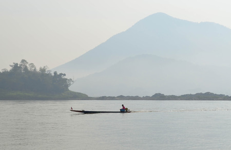 boatman: Boatman Sailing Motorboat In The River, Cloudy View