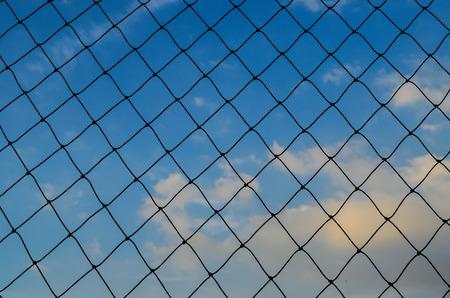 soccer net: Black soccer net texture againt  blue sky