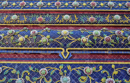wat pho: Colorful vintage flower ceramic tile decoration at buddhist temple , Wat Pho Bangkok, Thailand Stock Photo