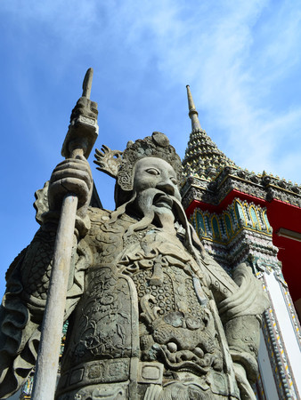 imperialism: Stone sculpture of Chinese guardian at the entrance of Thai Temple, Wat Pho, Bangkok, Thailand Stock Photo