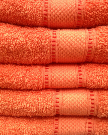 Stacked of orange towel, close up view