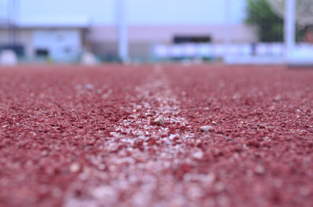 racetrack: Blurred red racetrack rubber texture Stock Photo