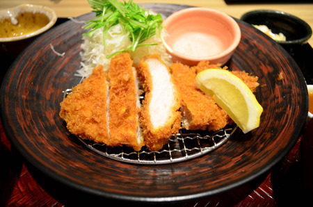 japanese cookery: Japanese deep fried pork cutlet  (tonkatsu) with slice cabbage and lemon
