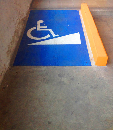 Ramp access for disable people with blue and white symbol Banco de Imagens