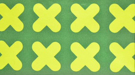 Yellow criss-cross symbol on green canvas fabric fiber for texture and background Stock Photo