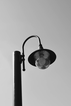 magazine stack: Lamp post against  sky in black and white tone