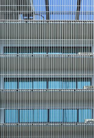 batten: Metal batten facade in front of modern building Stock Photo