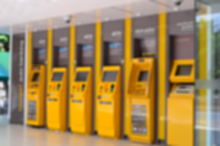 automatic teller: Blurred yellow automatic teller machine, ATM Stock Photo