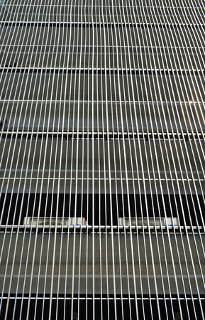 lath in modern: Metal batten facade in front of modern building Stock Photo