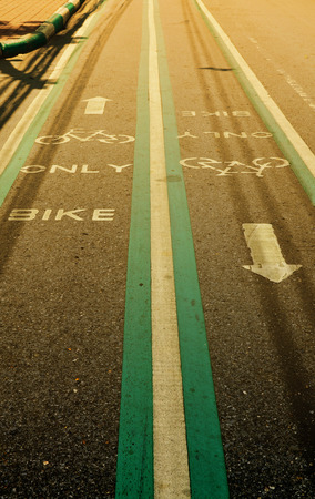 stated: Bicycle lane on asphalt road with word stated BIKE ONLY, vintage filter effect - sport and healthy lifestyle concept