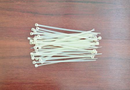 nylon: White nylon cable tiles on wooden background Stock Photo