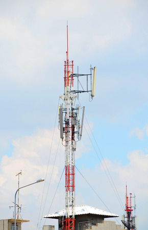 hazy: Telecommunication tower against hazy blue sky day