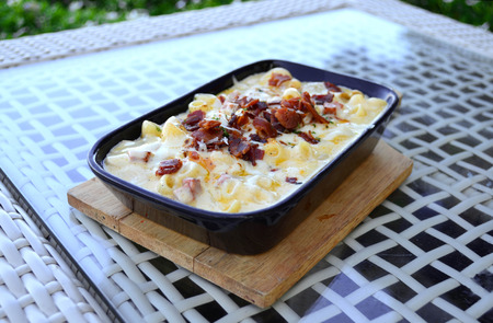 macarrones: Tasty baked macaroni with cheese and bacon - traditional Italian cuisine