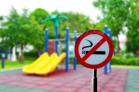 No smoking sign with children playground background - healthy concept