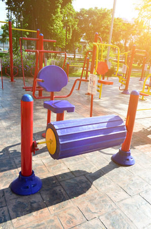 outdoor exercise: Colorful outdoor fitness gym in public park under sun light in the morning