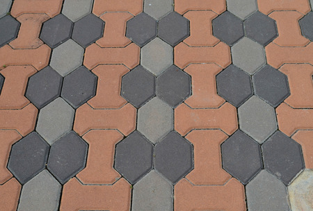 Clean gray and orange cement block pavement