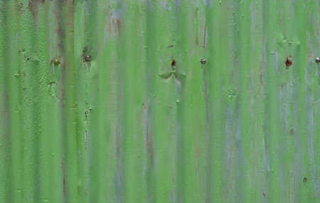 Rusted and pale green galvanized iron sheet Stock Photo