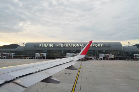 Penang International Airport terminal and airplane wing view during takeoff Stock fotó - 77360479