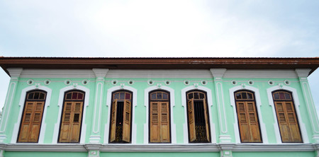 second floor: Second floor of green Penang heritage house over hazy sky Stock Photo