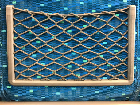 Back pocket seat of Japan train, made from rope net Stock Photo