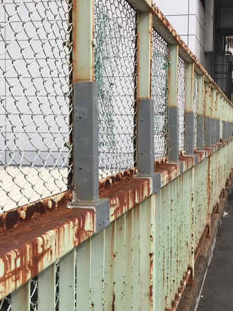 Rusted iron fence, side view, security and architecture concept