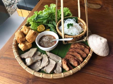 Vietnamese food set, bun dau mam tom, popular street food made from vermicelli with boiled pork, fried tofu, shrimp paste and green vegetables and lemon