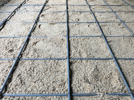 Rebar on sand for foundation at construction site Stok Fotoğraf - 101228959