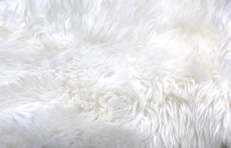 Texture of white and fluffy synthetic fur