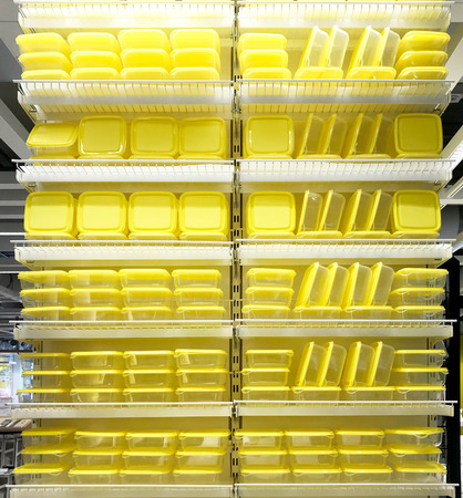 Stack of yellow food containers in kitchenware store