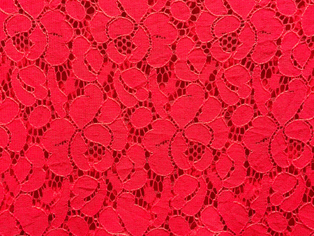 Detail of red flower lace fabric texture and background