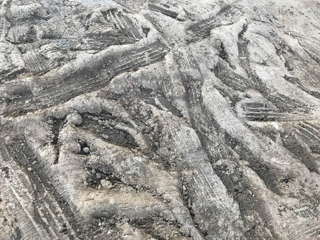 Rough wheel tread trace on earth or clay