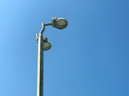 Street lamp post over blue sky background