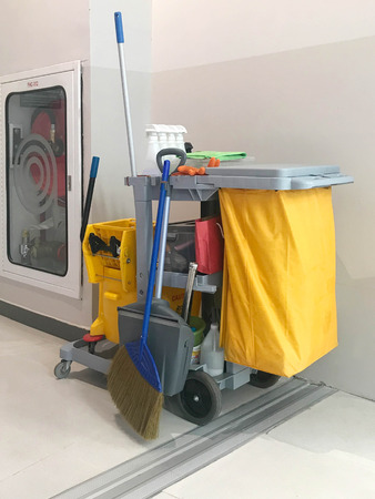 Cleaning supplies cart wait for service. Bucket and set of cleaning equipment in department store or commercial building