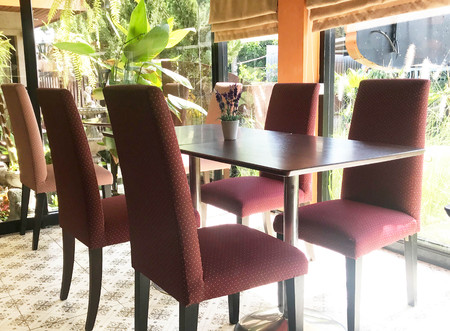 Empty table and red soft chair in coffee shop or  restaurant  - interior design