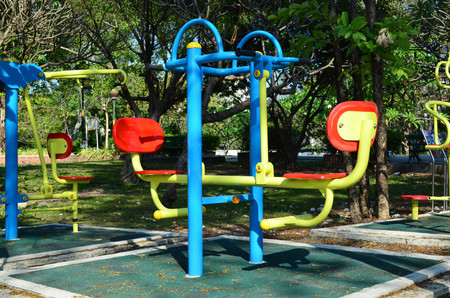 Colorful outdoor fitness gym in public park under sun light in the morning