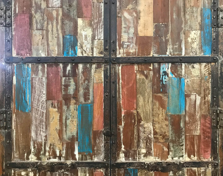 Pattern of grunge and old painted wooden panel of cupboard for background and texture